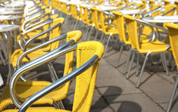 Yellow cafe chairs in San Marco Piazza. In Venice with selected focus Royalty Free Stock Photos