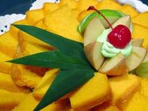 Yellow cake and cherry Royalty Free Stock Photo