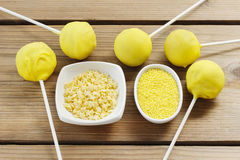 Yellow cake pops Stock Photography