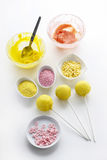 Yellow cake pops  on white background Royalty Free Stock Images