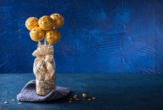 Yellow cake pops. In a vase royalty free stock photos