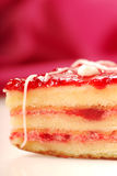 Yellow cake with strawberry glaze petifore Royalty Free Stock Images