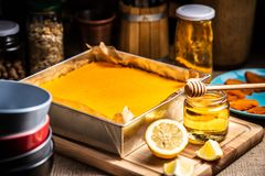 Yellow cake tart on a wooden board royalty free stock photo