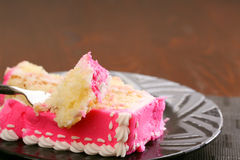 Yellow cakes with pink frosting Stock Photography