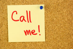 Yellow call me sticker on the cork Royalty Free Stock Images
