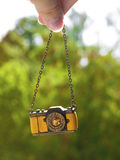 Yellow camera-shaped necklace Royalty Free Stock Photography