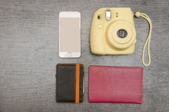 Yellow camera, smartphone, wallet and passport. Empty space. Top Stock Images