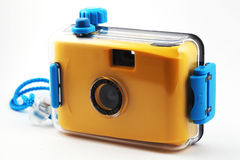 Yellow camera in waterproof box. Over white Royalty Free Stock Photography