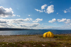 Yellow camping tent on a shore Royalty Free Stock Images