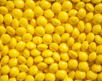 Yellow Candies. Bright yellow candies for a textured background stock image