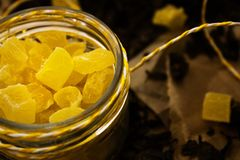 Yellow candies on a dark background space for additional text stock photography