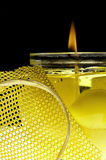 Yellow candle. With a net stock images