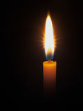 Yellow candle  bright light Stock Photography