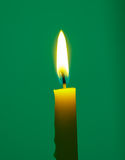 Yellow Candle on green background Stock Photography