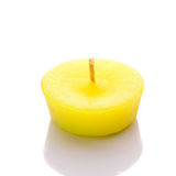 Yellow candle isolated on white background Stock Photos