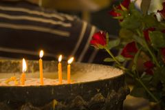 Yellow candle on the pot with sand. royalty free stock photos