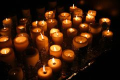 Yellow candles. Candles on black background Stock Photo