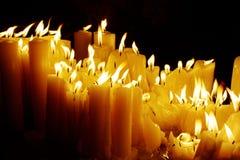 Yellow candles at night Royalty Free Stock Photos