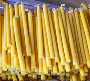 Yellow candles pile. Royalty Free Stock Photos