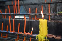 Yellow Candlesticks lit on the prayer shelf in Buddhist Temple Shrine. Buddhism, Asian traditional religious ceremony, Rituals, Ma. King a wish, Meditation stock images