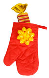Yellow candy in red heat protective mitten Stock Images