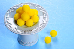 Yellow candy. In sugar, round shape. Selective focus Stock Photo