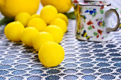 Yellow candy. In sugar, round shape. Selective focus stock images