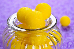 Yellow candy. In sugar, round shape. Selective focus royalty free stock images