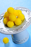 Yellow candy. In sugar, round shape. Selective focus stock image