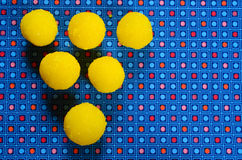 Yellow candy. In sugar, round shape. Selective focus royalty free stock image