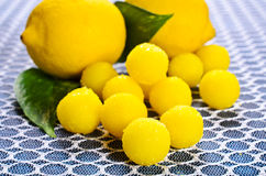 Yellow candy. In sugar, round shape. Selective focus stock photos