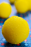 Yellow candy. In sugar, round shape. Selective focus royalty free stock photography