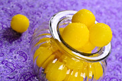 Yellow candy. In sugar, round shape. Selective focus stock photography