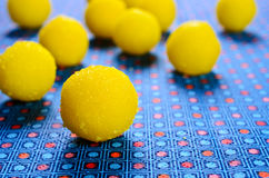 Yellow candy. In sugar, round shape. Selective focus Royalty Free Stock Photo