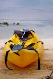 Yellow canoe on beach in Belize Stock Photography