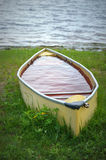 Yellow Canoe Filled With Rainwater Stock Photo