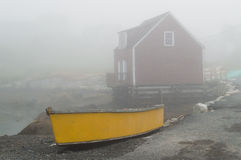 Yellow Canoe in the Fog Stock Photography