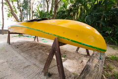 Yellow canoe at the tropical beach Royalty Free Stock Photography