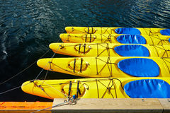 Yellow canoes, kayaks , 5 pieces, are on the water Stock Photos