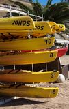Yellow canoes stacked Soller Mallorca royalty free stock photography