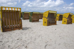 Yellow canopied beach chairs at Baltic Sea. Lots of yellow canopied beach chairs at Baltic Sea Stock Images