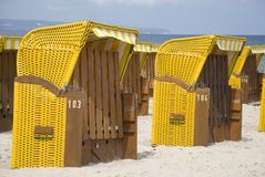Yellow canopied beach chairs at Baltic Sea Stock Images