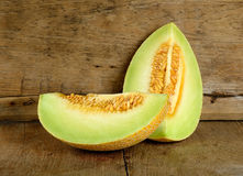 Yellow cantaloupe melon on the wooden background Royalty Free Stock Images