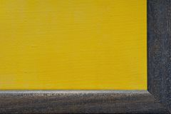 Yellow canvas is in blue  frame Royalty Free Stock Image
