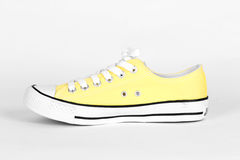 Yellow canvas shoes Stock Images