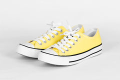 Yellow canvas shoes Stock Photos