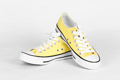 Yellow canvas shoes Stock Image