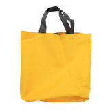 Yellow canvas shopping bag isolated on white Stock Photos