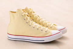 Yellow canvas sneakers Royalty Free Stock Images