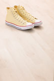 Yellow canvas sneakers Royalty Free Stock Photo